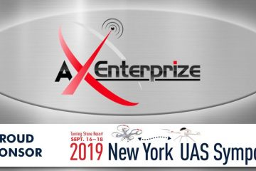 a photo of AX Enterprize logo with an antenna on the tip of the X that reads that they are proud sponsors of the Turning Stone Resort Casino September 16-18 of 2019