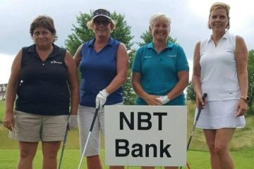 a photo of 4 ladies standing at a golf tee for a golf outing with NBT Bank